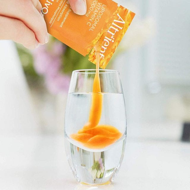 Picture of vitamin C supplement Altrient being poured into a glass